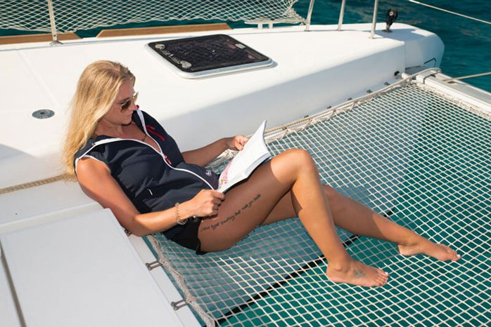 Catamaran lady enjoying Croatia